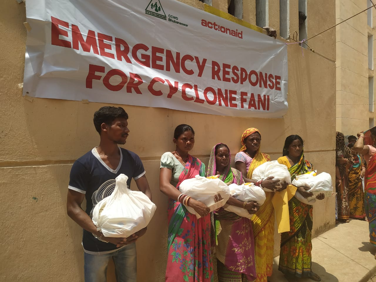 Families affected by Cyclone Fani receiving relief materials