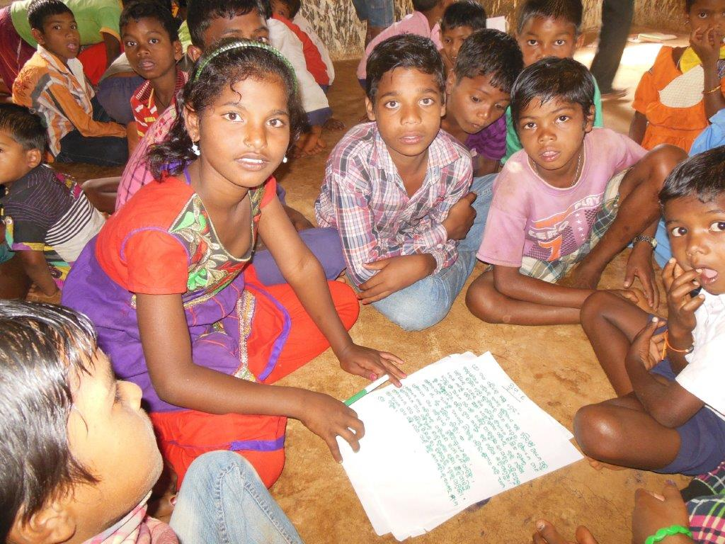 Children supporting each with other with school work and education