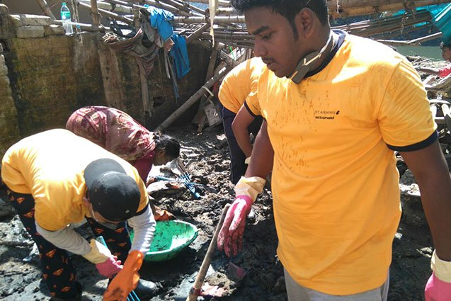 Volunteers from Jet Airways helping clean houses on Appasamy Street, Chennai